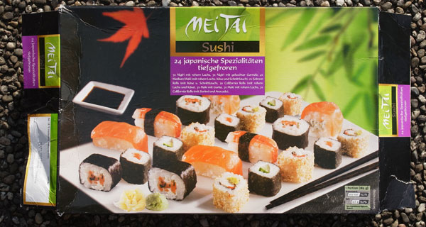 The complete package with a photo of the sushi rolls on the front and a separate description of how many sushi rolls of which type are in the package